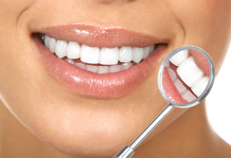 dentist: Healthy woman teeth and a dentist mouth mirror  Stock Photo