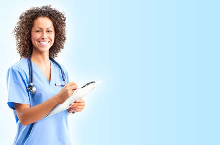 care worker: Smiling medical doctor with stethoscope. Over blue background