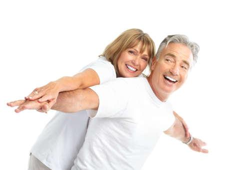 familia saludable: Las personas de edad feliz pareja de enamorados. Dientes sanos. Aislados sobre fondo blanco