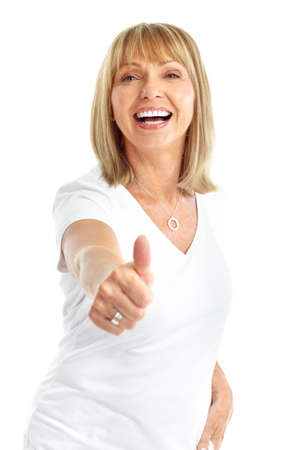 Smiling happy elderly woman. Thumb. Isolated over white background  Stock Photo