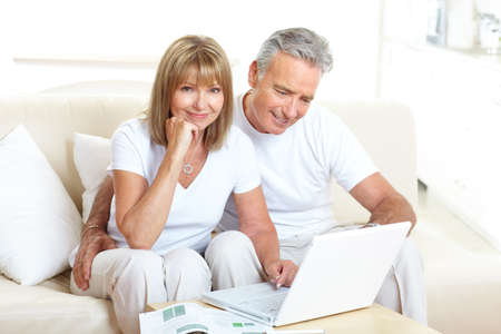 mature male: Seniors couple  working with laptop at home