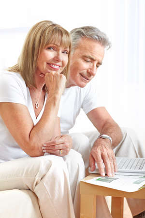 work from home: Seniors couple  working with laptop at home