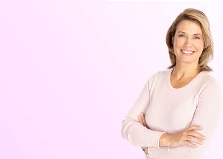 maturity: Smiling happy mature woman. Over pink background