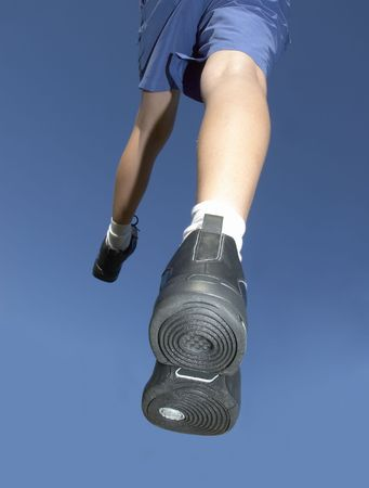 jogging shoes in air