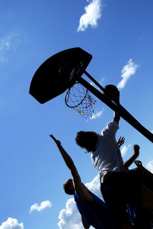 silhouettes of the street basketball photo