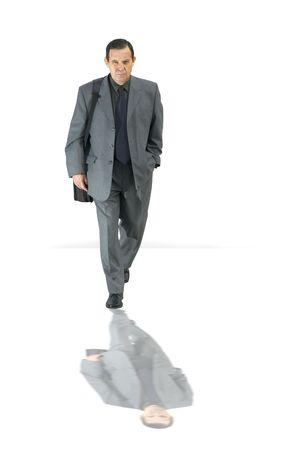 businessman walking with reflection Stock Photo
