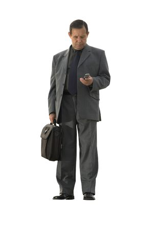 businessman standing with cell-phone photo