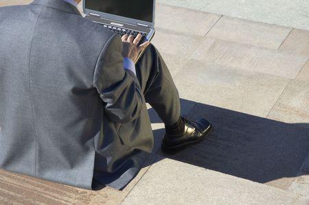 moneymaker: working on the laptop Stock Photo