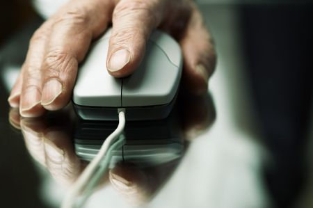 hand of the man with computer mouse,focus point on the finger,special tone photo fx photo