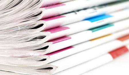 broadsheet newspaper: heap of magazines Stock Photo
