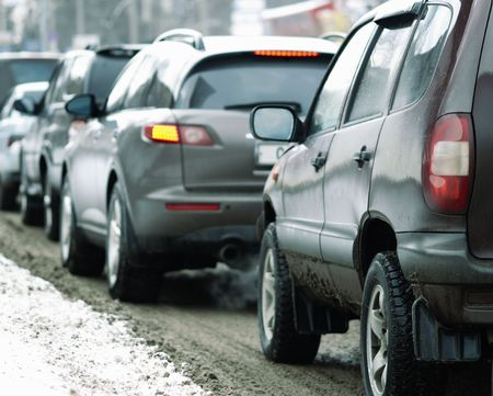 traffic jam (winter time,focus point on the automotive head lamp of the nearest car) Stock Photo - 772506
