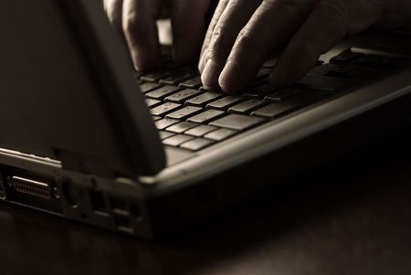 work on the laptop (special sepia photo f/x,focus point on the finger) Stock Photo - 800925