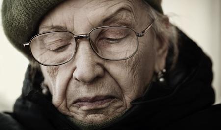 depressed woman: older woman with eyeglasses