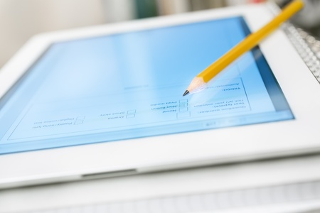 input devices: Digital tablet on stack of notebooks and textbooks