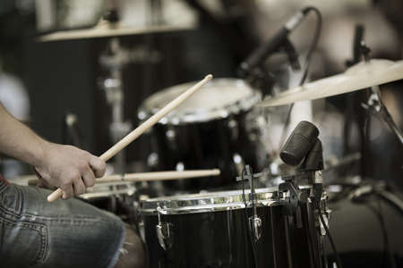 detail of a drummer on the rock concert, selective focus on hands photo