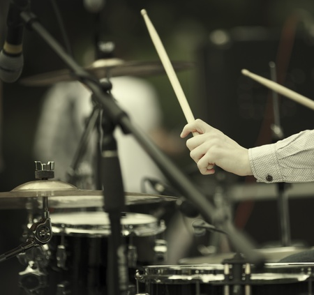 drum kit: detail of a drummer on the rock concert, selective focus on hands