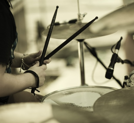 hands of the drummer on the rock concert, selective focus on hands Stock Photo
