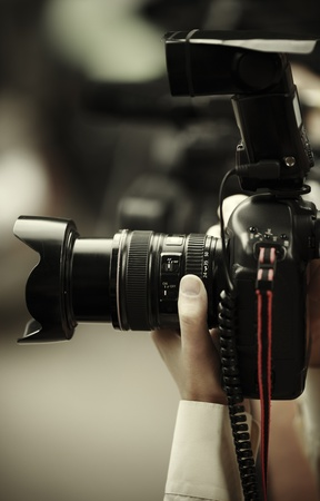 photography themes: digital camera with flash, selective focus on lens