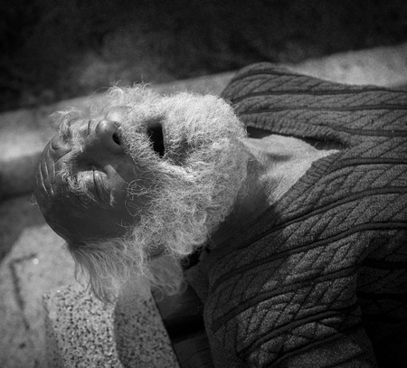 old beggar: real homeless man sleeping on the street
