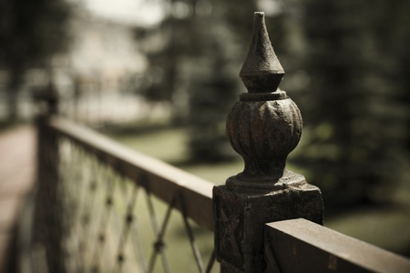 wrought: urban concept with wrought iron fence detail   selective focus  on nearest part