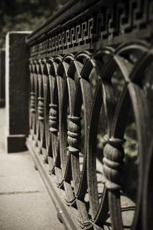 wrought: urban concept with wrought iron fence detail   selective focus  on center part  Stock Photo