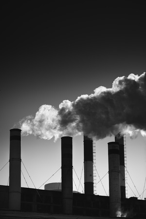 admixture: industrial tubes pollute the environment , ecology concept