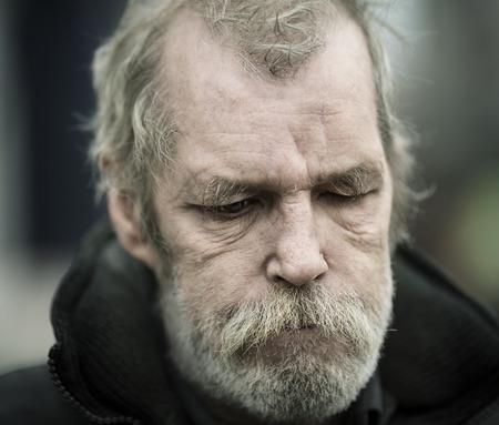 real homeless man , selective focus on eye Stock Photo
