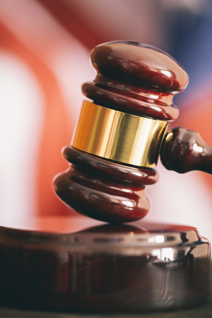 acquittal: Gavel and american flag, symbol for jurisdiction , selective focus