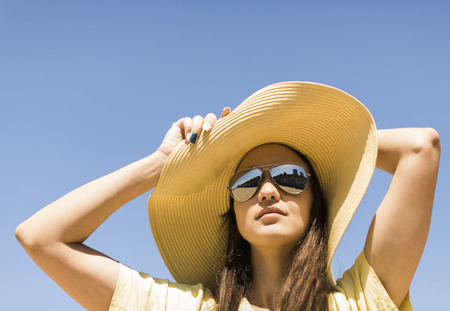 summer portrait of young woman with hat . Stock Photo
