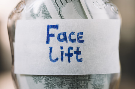face lift: jar with money in closeup for face lift Stock Photo