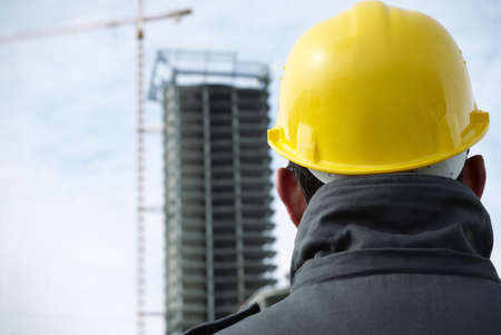 construction hat: builder (special toned photo fx with vignetting, focus on the hard-hat) Stock Photo