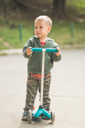 aciculum: Boy With his scooter Stock Photo