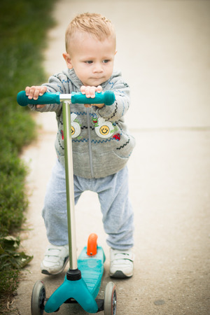 aciculum: Baby Boy On A Scooter