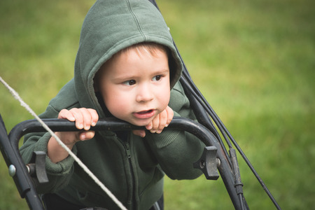 mowing grass: Toddler mowing grass Stock Photo