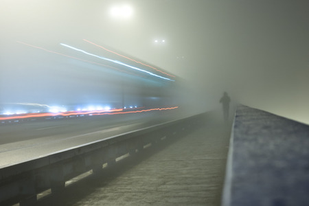 myst: man crossing the bridge in the myst