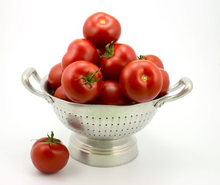 a colander: Isolated colander with tomatoes