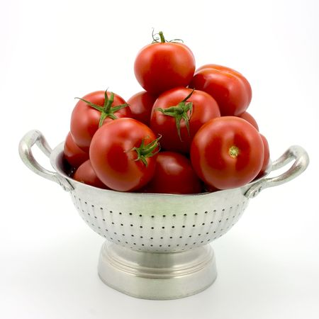 Isolated colander with tomatoes