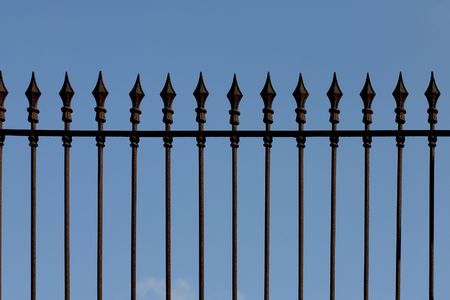 ancient blacksmith: Rusty iron picket fence