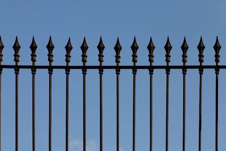 Rusty iron picket fence Stock Photo - 414305