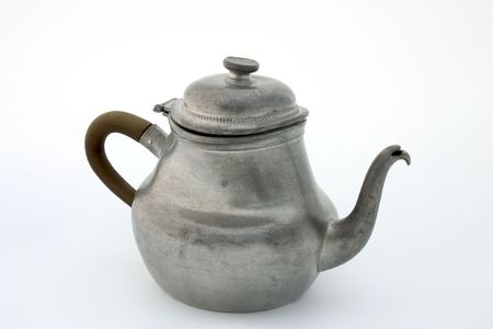Ancient pewter teapot, isolated photo