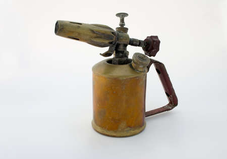 Old brass blowtorch, isolated