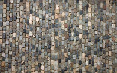 cobblestone street: Traditional pavement; a street paved with cobblestone