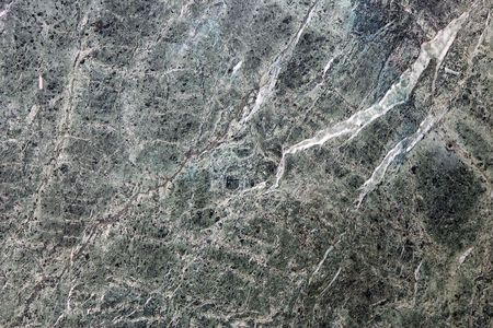Close-up of a rough green marble wall