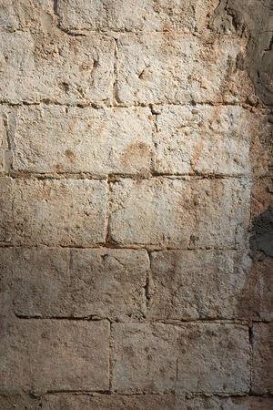 repaired: An ancient wall repaired with fresh cement