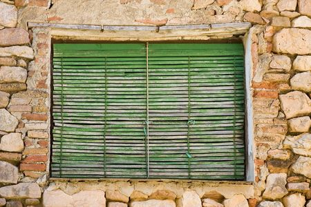 Weathered window with an aged green shade Stock Photo - 721525