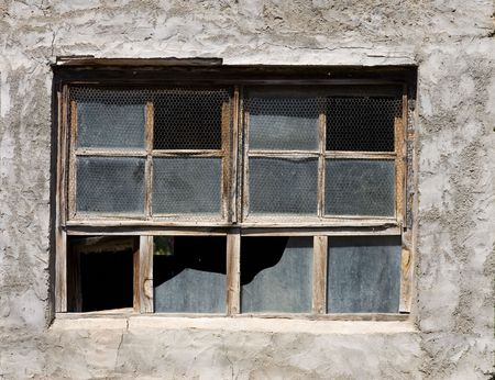 Aged window with broken glasses and wire mesh Stock Photo - 721524