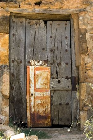 Aged wooden door in an ancient house photo