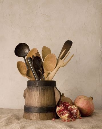 Still life; old wood and metal kitchenware and pomegranates photo