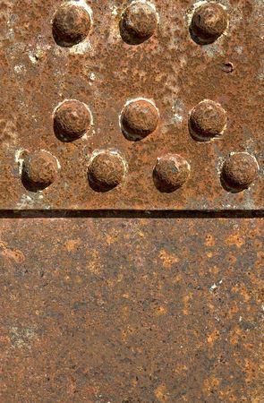 girder: Close-up of a rusty iron girder  with rivets