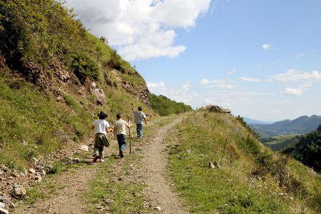 ramble: Three children hiking along a mountain path